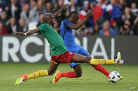 France's Blaise Matuidi, right, is tackled by Cameroon's Allan Nyom during a friendly soccer match between France and Cameroon at the La Beaujoire Stadium in Nantes, France, May 30, 2016.