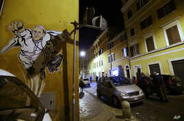 A graffiti depicting Pope Francis as Superman and holding a bag with a writing which reads: 'Values' is seen on a wall of the Borgo Pio district near St. Peter's Square in Rome, Tuesday, Jan. 28, 2014.
