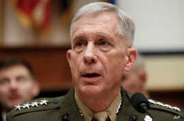 """Marine Gen. Thomas Waldhauser speaks before the start of a hearing before the House Armed Services Committee on Capitol Hill in Washington, March 6, 2018, about """"National Security Challenges and U.S. Military Activities in Africa."""""""