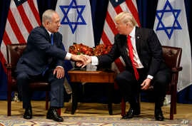 President Donald Trump shakes hands with Israeli Prime Minister Benjamin Netanyahu during a meeting at the Palace Hotel during the United Nations General Assembly in New York, Sept. 18, 2017.