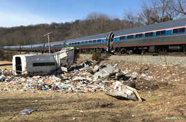 An Amtrak passenger train carrying Republican members of the U.S. Congress from Washington to a retreat in West Virginia is seen after colliding with a garbage truck in Crozet, Va., Jan. 31, 2018.