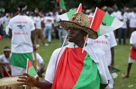 """Burundians attend a ruling party rally at the end of the campaign for a """"yes"""" vote in the constitutional referendum, in the capital Bujumbura, Burundi, May 14, 2018."""