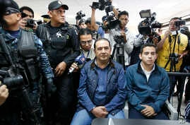"Jose Manuel Morales, the son of Guatemala's President Jimmy Morales, right, and his uncle Samuel ""Sammy"" Morales, center, sit in a courtroom in Guatemala City, Jan. 18, 2017. Both are being investigated for their involvement in a corruption case."
