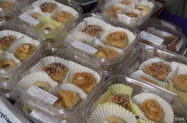 Syrian sweets are displayed at a Syrian Sweets Exchange event at a local bookstore in Phoenix, Arizona.