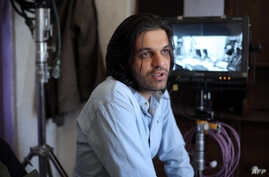 "An undated photo provided by Iranian filmmaker Keywan Karimi, shows Karimi during work on a scene in the movie ""Drum"", in Tehran early in 2016."