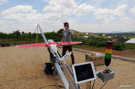 A Zipline engineer prepares a a drone for test flight at an operations base in Muhanda, south of Rwanda's capital, Kigali. Zipline, a California-based robotics company, delivered its first blood to patients using a drone, Oct. 12, 2016.