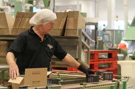 An employee packs boxes of tea at the production line at Taylors of Harrogate's tea packaging facilities in Harrogate, England, Aug. 30, 2016.