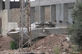 A Syrian government military vehicle is seen in Talbiseh near Homs, Syria, May 22, 2012.