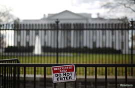A restricted area sign is seen outside of the White House in Washington on Nov. 27, 2015. A man who jumped the White House fence on Thursday was quickly caught and now faces criminal charges.