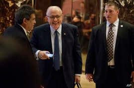 Rudy Giuliani (center) leaves Trump Tower, Friday, November 11, 2016, in New York. The former New York Mayor is expected to be considered for the position of attorney general for President Donald Trump.