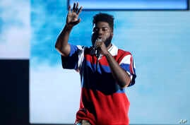 FILE - Khalid performs at the American Music Awards in Los Angeles, Nov. 19, 2017. Khalid is nominated for five Grammy Awards.