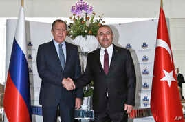 Russian Foreign Minister Sergei Lavrov, left, and Turkish Foreign Minister Mevlut Cavusoglu shake hands before a meeting of Turkey-Russia joint strategic planning group in Alanya, Antalya, Turkey, Thursday, Dec. 1, 2016.