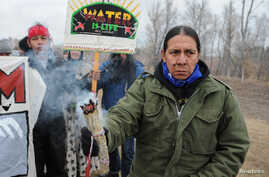 Protesters block highway 1806 in Mandan, North Dakota, during a protest against plans to pass the Dakota Access pipeline near the Standing Rock Indian Reservation, Nov. 23, 2016.