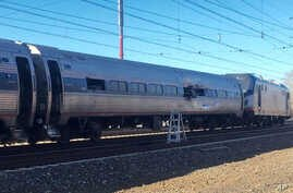 This photo shows an Amtrak train following an accident Sunday, April 3, 2016, in Chester, Pennsylvania. Amtrak said the train was heading from New York to Savannah, Ga., when it struck a backhoe outside of Philadelphia.