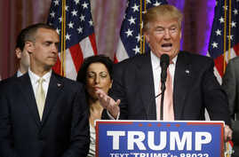 Republican presidential candidate Donald Trump speaks to supporters at his primary election night event at his Mar-a-Lago Club in Palm Beach, Fla., March 15, 2016. At left is his campaign manager Corey Lewandowski.