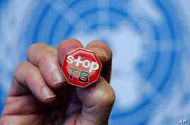 """File - A pin reading """"Stop TB"""" is shown after presentation of WHO report Global Tuberculosis Control at the United Nations headquarters, Geneva, Switzerland"""
