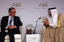 U.N. Deputy Secretary-General Jan Eliasson, left, listens to Abdullatif al-Zayani, Secretary General of the Gulf Cooperation Council, during the opening day of the Beirut Institute Summit, in Abu Dhabi, United Arab Emirates, Oct. 10, 2015.