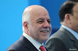 Iraqi Prime Minister Haider al-Abadi arrives for the second day of a NATO summit in Brussels, Belgium, July 12, 2018.