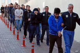 Police officers escort people, arrested because of suspected links to U.S.-based cleric Fethullah Gulen, in Kayseri, Turkey, April 26, 2017.