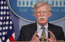 "U.S. National Security Adviser John Bolton answers questions from reporters after announcing that the U.S. will withdraw from the Vienna protocol and the 1955 ""Treaty of Amity"" with Iran in the White House briefing room in Washington, Oct. 3, 2018."