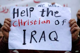 An Iraqi Christian who lives in Lebanon holds a placard during a sit-in, in front of the United Nations Headquarters demanding speeding up their immigration cases in Beirut, Lebanon, Feb. 13, 2017.