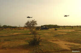 French military helicopters fly above the crash site of Air Algerie flight AH5017 near the northern town of Gossi, Mali, July 24, 2014.