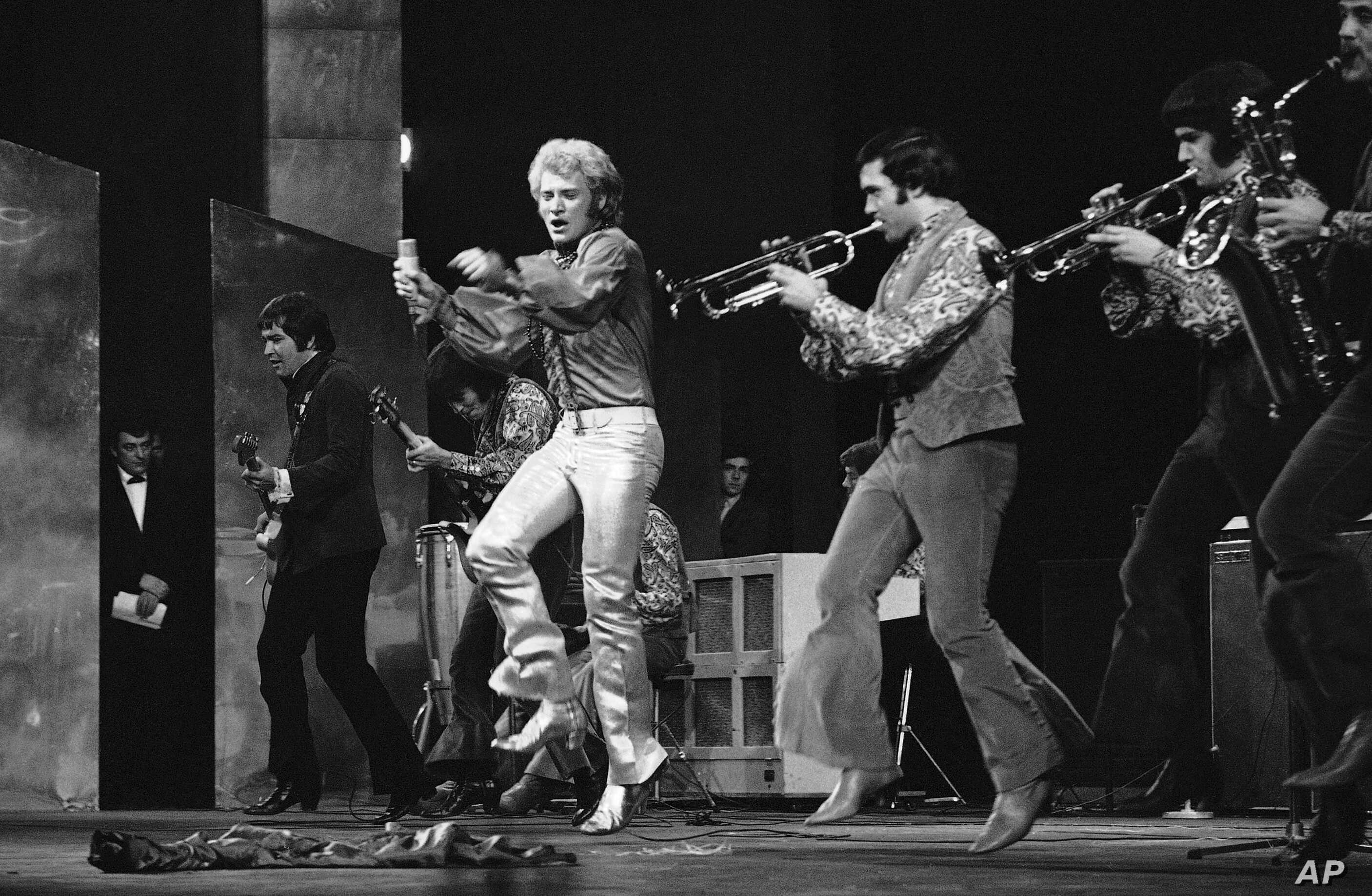 FILE - In this Dec. 16 1967 French rock singer Johnny Hallyday performs at the Palais de Chaillot in Paris.