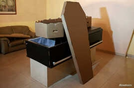 A cardboard coffin is seen at a mortuary in Valencia, in the state of Carabobo, Venezuela, Aug. 25, 2016.