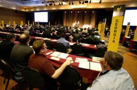 Delegates listen to speeches in the main hall at the National Libertarian Party Convention, May 27, 2016, in Orlando, Fla.