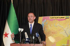 FILE - Syrian National Coalition spokesman Khaled Saleh speaks during a news conference in Istanbul,September 3, 2013.