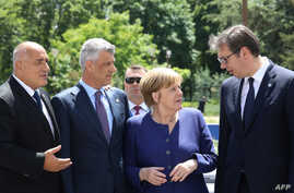 From left, President Hashim Thaci , German Chancellor Angela Merkel and Serbian President Aleksandar Vucic speak together prior to the family photo during an EU-Western Balkans Summit in Sofia on May 17, 2018.