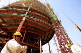 A Chinese engineer supervises at a construction site in Sudan's capital Khartoum. China - Africa trade has risen 10-fold since 2000 to nearly $107 billion last year. REUTERS/Mohamed Nureldin Abdallh