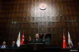 FILE - Turkish President Recep Tayyip Erdogan addresses members of parliament from his ruling AK Party (AKP) during a meeting at the Turkish parliament in Ankara, Turkey, March 6, 2018.