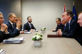 British Prime Minister David Cameron, second right, speaks with European Council President Donald Tusk, second left, during a bilateral meeting on the sidelines of an EU summit in Brussels on Thursday, Feb. 18, 2016.