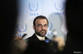 FILE - Iran's ambassador to the International Atomic Energy Agency (IAEA) Reza Najafi attends a news conference at the headquarters of the IAEA in Vienna, December 2013.