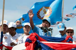 Cambodian Prime Minister Hun Sen, center, of the Cambodian People's Party (CPP), waves from a truck as he leads a rally in Phnom Penh, Cambodia, June 2, 2017. Early results show the from the June 4 commune poll show the CPP in a solid lead over compe...