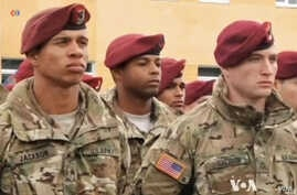 In this image taken from video, American military trainers are seen at the launch of joint U.S.-Ukrainian exercises in Yavoriv, Lviv region, western Ukraine, April 20, 2015 (video by VOA's Al Pessin).