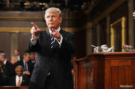 President Donald Trump reacts after delivering his first address to a joint session of Congress from the floor of the House of Representatives iin Washington, Feb. 28, 2017.