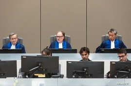Judge Cuno Tarfusser (C), judge Chang-ho Chung (R) and judge Marc Perrin de Brichambautat (L) issue a ruling on South Africa's failure to arrest Omar al-Bashir, during a session of the ICC in The Hague, July 6, 2017.