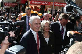 Prime Minister Malcolm Turnbull greets people during a walk through a shopping street in Burwood, Sydney, Australia, Friday, July 1, 2016.