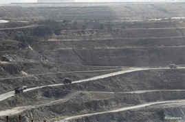 Trucks are seen at a copper mine in Sarlingyi township, December 14, 2012.