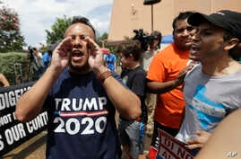 "FILE - A man who called himself a citizen taxpayer, left, argues with protesters at a a rally to oppose a new Texas ""sanctuary cities"" bill that aligns with the president's tougher stance on illegal immigration, June 26, 2017, in San Antonio, outside"