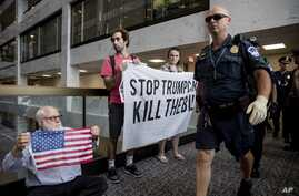 Capitol Hill police officers move in on a group protesting the Republican health care bill outside the offices of Sen. Dean Heller, R-Nev., on Capitol Hill in Washington, July 17, 2017.