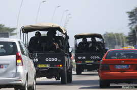 Security forces drive towards Grand Bassam in Abidjan, Ivory Coast, March 13, 2016.