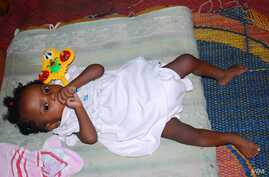 Five-month-old Jessica was taken in by one of the few houses in Nigeria that will care for HIV positive babies.  Aid workers say many babies like her die in trash bins or on the sides of the roads. (I. Yakubu/VOA)