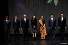 FILE - Japan's Prime Minister Shinzo Abe stands for photo with fellow Southeast Asian leaders at the 31st ASEAN Summit, in Manila, Philippines, Nov. 13, 2017.