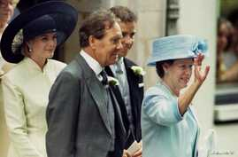 FILE - Lord Snowdon (C) and his then former wife, Princess Margeret (R), are seen leaving St. Stephen Walbrook church in London, July 14, 1994, following the wedding of their daughter, Lady Sarah Armstrong Jones (not pictured).