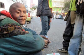Buhlebezwe Mlambo is mentally ill and homeless. His friend Sello looks after him on the street, June 13, 2013 (G. Parker/VOA).