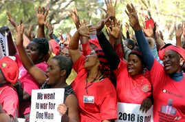 Opposition party supporters take part in a march for transparency on the streets of Harare, July 11, 2018.
