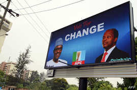 An electronic billboard displaying a campaign poster of leading opposition All Progressives Congress presidential candidate Mohammadu Buhari and his running mate Yemi Osinbajo  in the Ikoyi district of Lagos, Nigeria, Feb. 24, 2015.